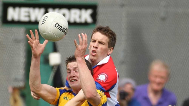 Kevin Higgins, goalscorer for Roscommon, clashes with Stephen Harold of New York