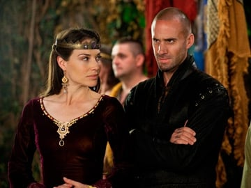 Claire Forlani as Igraine and Joseph Fiennes as Merlin