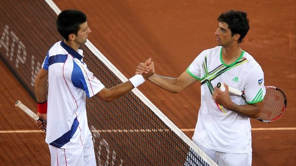 Novak Djokovic (left) - is congratulated by Thomaz Bellucci after their semi-final match in Madrid