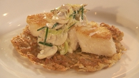 Cod with Rosti - Plate your rosti and lay the cod on top and a few dollops of cream sauce to finish.
