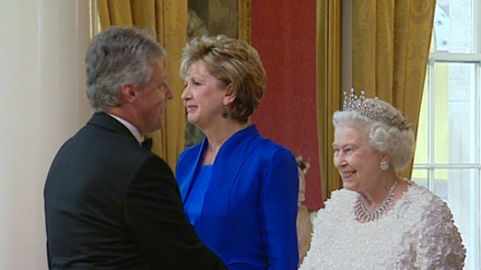 Peter Robinson is greeted by the Queen