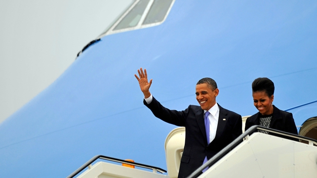 President Obama's plane touched down in wet and blustery conditions