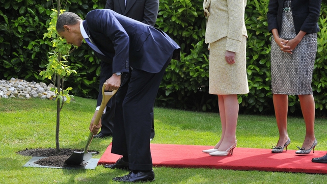 Mr Obama then planted a tree in the garden