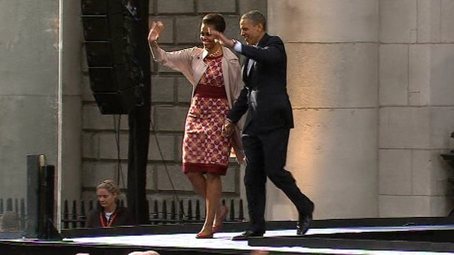 Michelle and Barack Obama wave to the crowds at College Green
