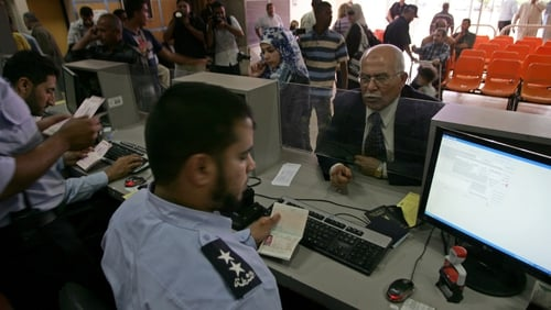Gaza - Palestinian border police check identity documents of travellers crossing into Egypt