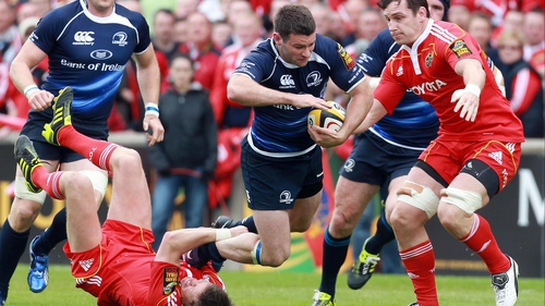 Hanging on - Ronan O'Gara takes down Fergus McFadden