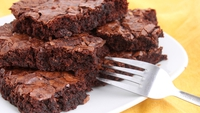 Super Chocolate Brownies - This recipe makes beautiful, dense and fudgy brownies - just the way I like them. It's a very simple recipe that you can make in minutes. Just make sure you make enough to share around!