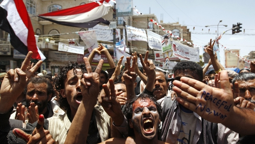 Sanaa - Anti-government protestors flash the V for 'victory' sign as they shout slogans during a demonstration