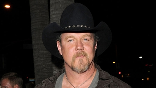 Trace Adkins lost his home in a fire
