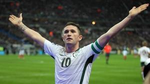 Robbie Keane - Celebrates scoring against France in 2009