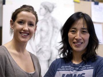Swimmer Melanie Nocher and artist Sahoko Blake, in the background Sahoko's portrait of Melanie