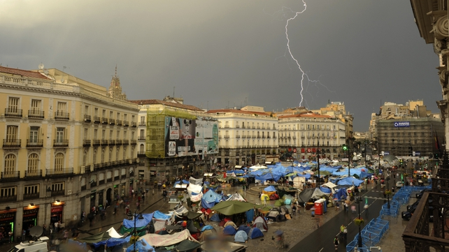 Protesters dismantled their camp at Puerta del Sol on Sunday