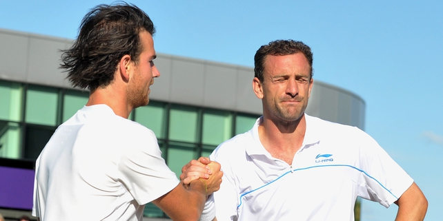A dejected Conor Niland congratulates Adrian Mannarino at SW19