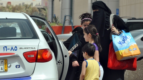 Saudi Arabia - Woman gets into a taxi
