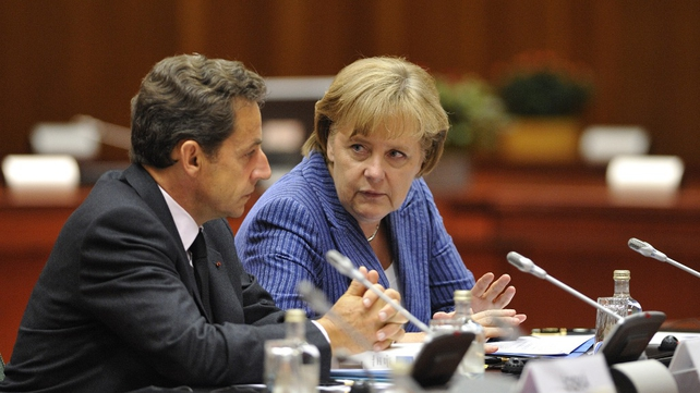 Nicolas Sarkozy and Angela Merkel - Talking at beginning of summit