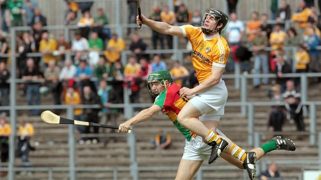 Antrim victory - Chris McGuinness out-jumps Carlow's Daryl Roberts as the Saffrons took the spoils at Casement Park