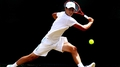 Tomic mauls Malisse to advance to last eight