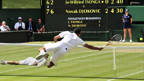 Jo-Wilfried Tsonga dives for a ball - The Frenchman and Novak Djokovic played a series of dramatic points