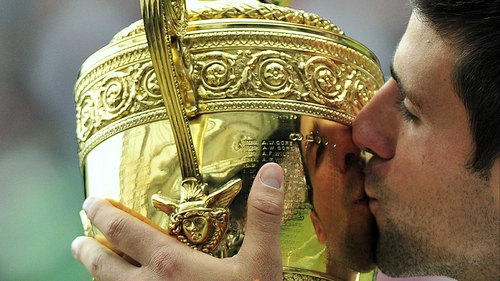 Novak Djokovic kisses the trophy - The Serb dominated the key points in the final