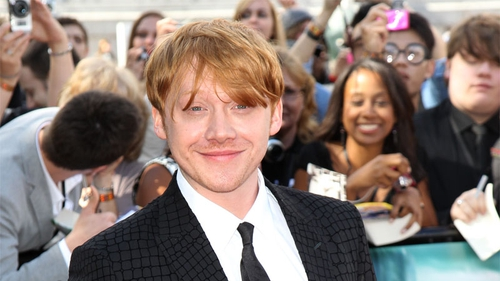 Rupert Grint - all smiles on the red carpet