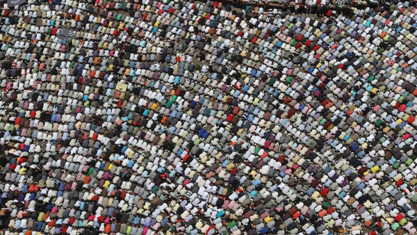 Egyptians - People attend prayers ahead of protests