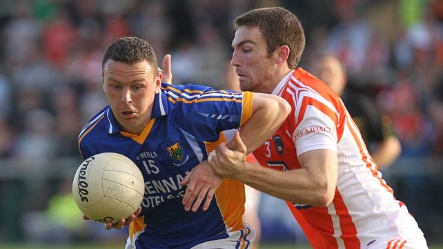 Leighton Glynn of Wicklow fends off Armagh's Brendan Donaghy