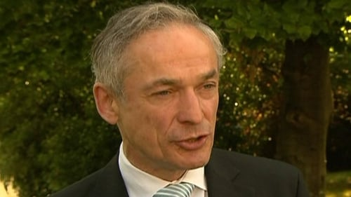 Richard Bruton is attending the signing of the agreement