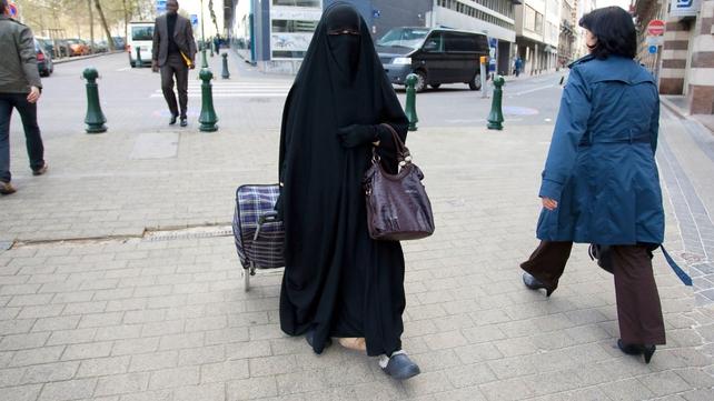 Belgium - A Muslim woman dressed in niqab walks through Brussels