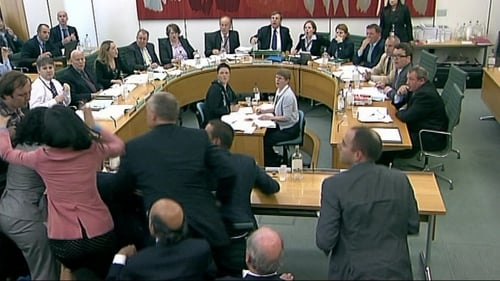 Commons Committee - Rupert Murdoch's wife Wendi (in pink) leaps to the defence of her husband