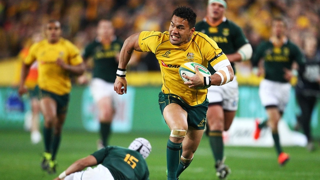 Digby Ioane races past Gio Aplon - South Africa could not contain Australia's pace and precision in attack