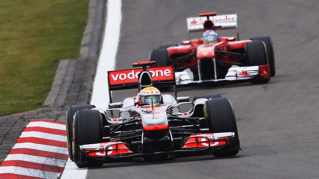 Lewis Hamilton (front) won the German Grand Prix, with Fernando Alonso (behind) finishing second