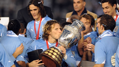 b9bcbaf4f Diego Forlan - The 32-year-old lifts the trophy after Uruguay s 3-