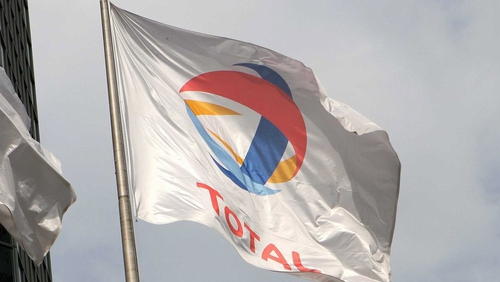 Total reports quarterly net profit of €1.5 billion from €3.7 billion in 2011