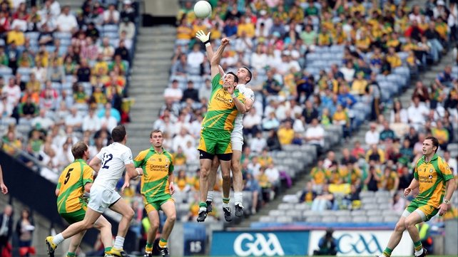 Rory Kavanagh goes up for a high ball against Kildare