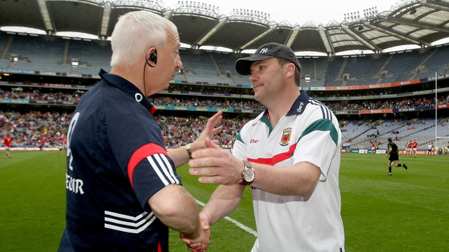 Conor Counihan (l) congratulates James Horan after Cork lost to Mayo