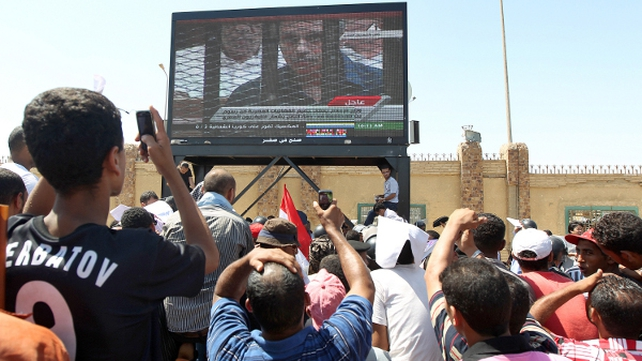 Cairo - Thousands gather outside to watch the trial on big screens