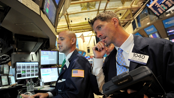 New York - A trader on the floor of the New York Stock Exchange at the opening bell