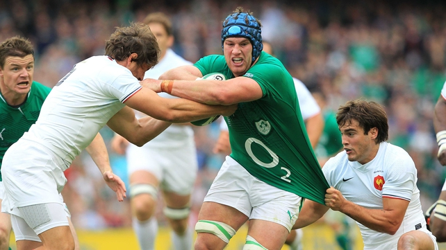 France's Cedric Heymans (left) and Alexis Palisson (right) tackle Ireland's Sean O'Brien