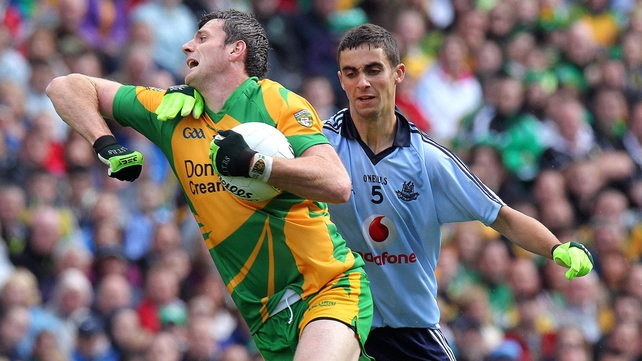 Christy Toye of Donegal & Dublin's James McCarthy in action at Croke Park