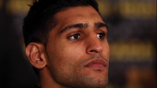 Amir Khan has revealed that he may part company with trainer Freddie Roach