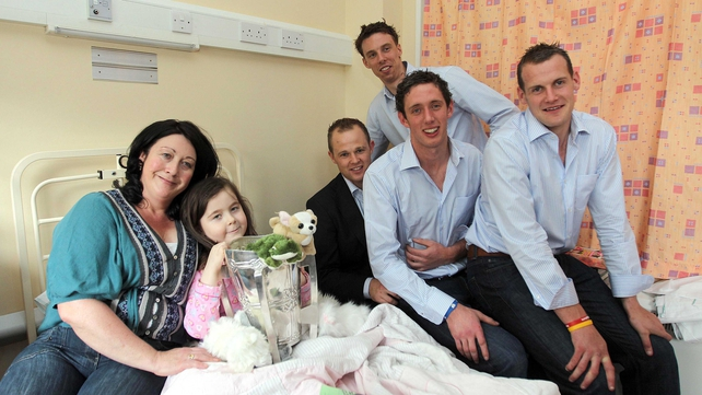 Tommy Walsh, Brian Hogan and JJ Delaney - the Kilkenny players are pictured with Saoirse Mullan and mum Deirdre from Thurles at Crumlin Hospital