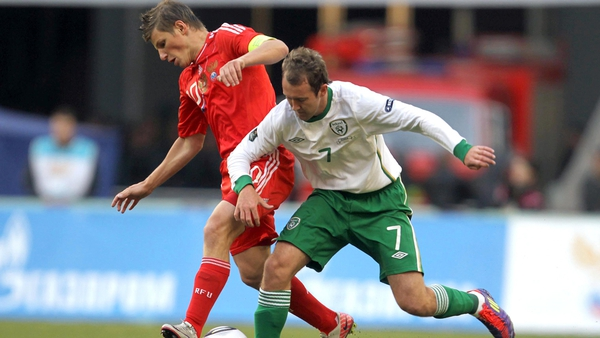 Under pressure - Aidan McGeady tracking back as Andre Arshavin breaks for Russia