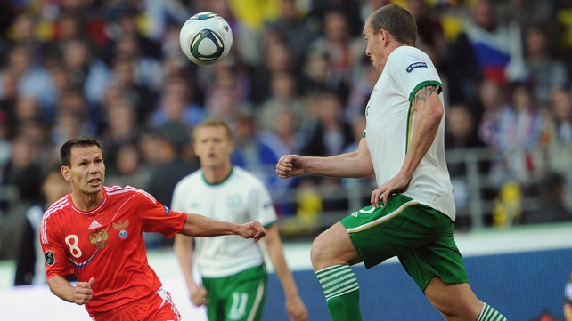 Richard Dunne gave a man-of-the-match display as the Irish hung on for a point