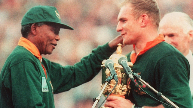 Mandela presenting South Africa captain Francois Pienaar with the World Cup in 1995