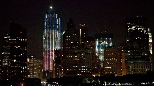 The new Freedom Tower is lit up in patriotic colours