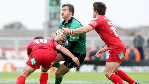 Matthew Jarvis of Connacht is double tackled by Dan Newton and Liam Williams of Scarlets