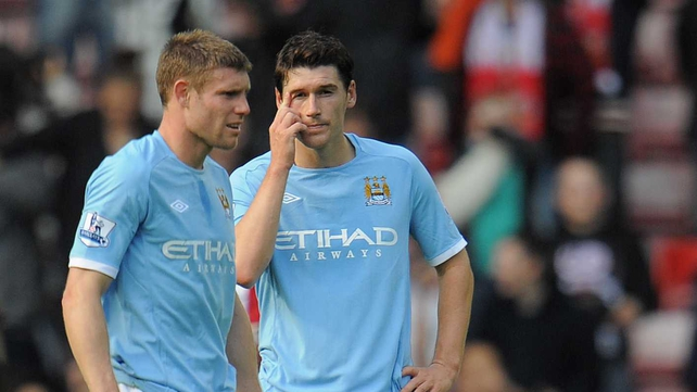 James Milner (l) will need to see a specialist about a toe injury which ruled him out of Sunday's tie with Arsenal
