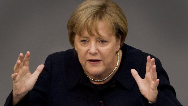 Angela Merkel before the German parliament's powerful budget committee today