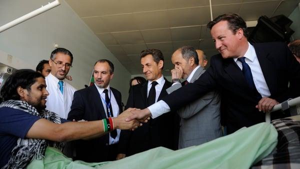 Nicolas Sarkozy and David Cameron meet patients at a medical centre