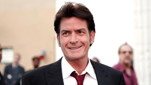 Charlie Sheen offers virtual olive branch to Rihanna